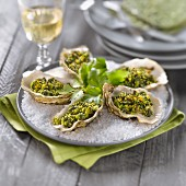Hot oysters with spinach, parsley and breadcrumbs