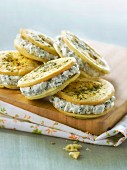 Garlic and herb cookie sandwiches filled with creamed goat's cheese with chives
