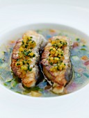 Grilled fish in vegetable broth