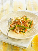 Sauteed seitan with carrots, green beans, sweet corn and beansprouts