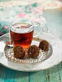 Oatmeal, fenugreek and carouba flour truffles with a cup of tea