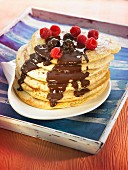 Pancakes with melted chocolate and raspberries