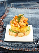 Shrimp,mild garlic and fennel omelette on a slice of bread