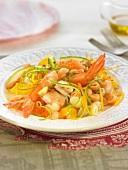 Pasta, shrimp, avocado, carrot, orange and fish roe salad