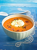 Tomato Salmorejo with diced raw ham and a poached egg