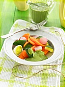 Steamed vegetables with green lentil and coconut milk sauce