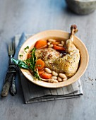 Chicken leg with white beans and carrots