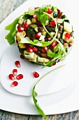 Zucchini,eggplant and pomegranate seed Timbale
