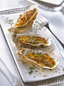 Grilled oysters with chopped parsley