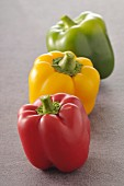 Three different colored bell peppers