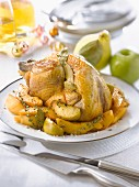Stuffed capon with quince,apples and herbs