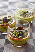 Pistachio cream dessert with stewed cherries