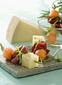 Tomme goat's cheese,melon and smoked duck breast mini brochettes