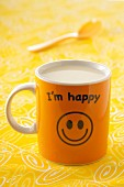 An 'I'm happy' mug of milk