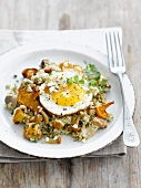 Quinoa with mushrooms and a fried egg