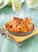 Gambas sauteed with garlic and crisp carrots with honey