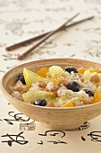 Thai rice salad with cashews,oranges,chicory and black olives