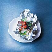 Cod cooked in aluminium foil