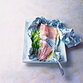 Trout cooked in aluminium foil