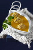 Butternut squash soup with green olive meatballs