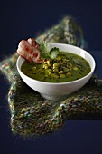 Split pea soup with black sesame seeds and bacon