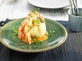 Small potato brioche with gambas, creamy tomato and Cognac sauce