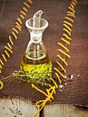 Small bottle of olive oil and thyme