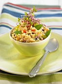 Pearl pasta salad with sprouts, red peppers, raisins and pine nuts