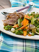 Lamb fillet with tamarind, peas and carrots