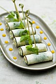 Black radish rolls stuffed with shrimps and fresh mint