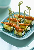 Grilled zucchini rolls stuffed with feta and sun-dried tomatoes