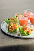 Summer vegetable tartare served in lettuce leaves and tomato gazpacho
