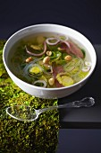 Brussels sprout broth with smoked duck magrets