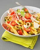 Penne with olives,cherry tomatoes,raw ham and parmesan