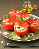Raw tomatoes stuffed with squid risotto