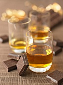 Glassses of liqueur and squares of chocolate