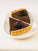 Portions of chocolate and prune tart