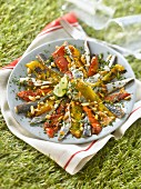 Grilled pepper, sardines marinated in lemon, cilantro and pine nut salad