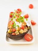 Eggplant stuffed with tomatoes and sauteed potatoes