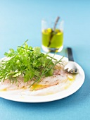Bass carpaccio with herbs