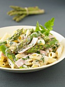Penne in cream sauce with asparagus and ham
