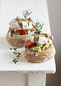 Feta, pesto, olive and tomato bread buns