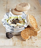 Leek and scallop fondue with thinly sliced truffles,toasted muffins