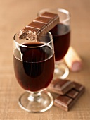Glasses of red wine and squares of chocolate