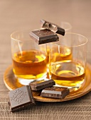 Glasses of Cognac with squares of dark chocolate