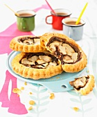 Pear and chocolate spread puff pastry tartlets