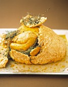 Chicken with thyme in salt crust
