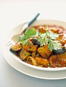 Veal with eggplants and tomato sauce