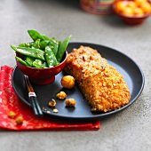 Salmon coated with crushed Japonese aperitif bites