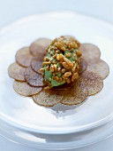 Nashi carpaccio with black sugar and caramelized puffed rice